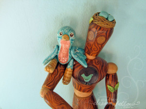 Jointed clay bird doll and painted wooden artist model